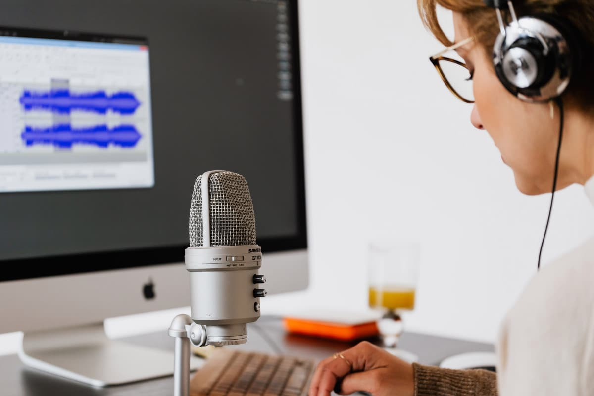person-using-microphone-4476163 Expert Advice: Learn How to Podcast on WordPress.com WordPress